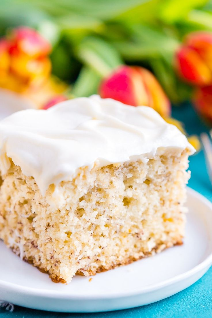 This is the Best Banana Cake recipe EVER! It's moist and sweet and topped with a tangy cream cheese frosting!