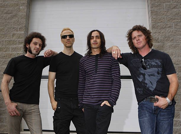 Left to right drummer Kevin Figueiredo lead singer Gary Cherone guitarist Nuno Bettencourt and bassist Pat Badger stand outside Cooper Studios where...