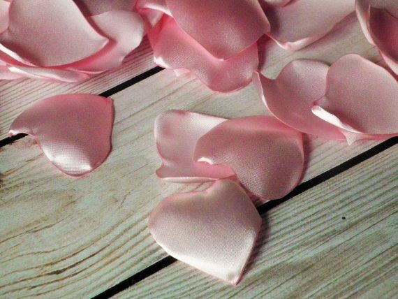 These heart shaped alternatives to real rose petals are hand cut from pink satin, and the edges are heat sealed to resist fraying. This is just a remnant; only 8 petals here! Each is about 1 1/2 - 2 in diameter. They are ready to ship!  More pink petals and wedding decor can be seen here: https://www.etsy.com/shop/ForeverSweethearts?search_query=pink
