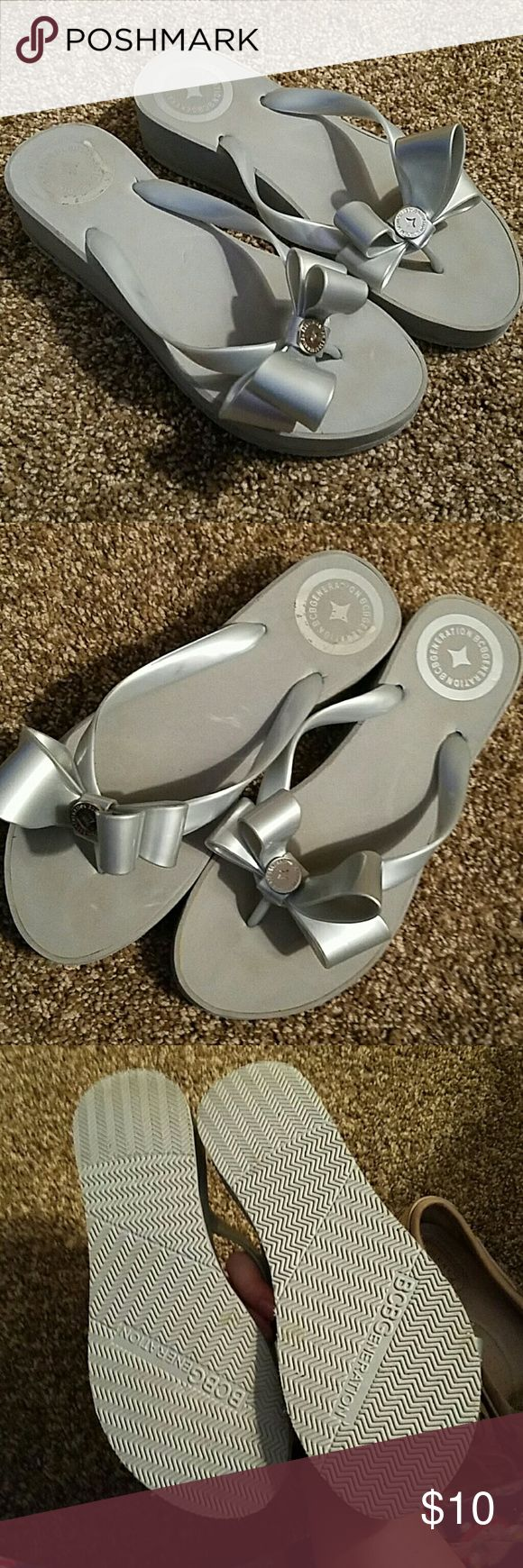 NWOT adorable BCBG bow flip flops! Like new, only wear is from sales sticker and store wear which may be easily removed. Adorable and comfortable! Heel is approximately two inches BCBGeneration Shoes Sandals
