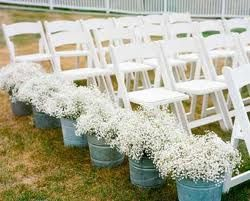 really like the idea of flower pots on the outside of the seating rows. The buckets could be wooden for a vintage wedding