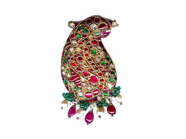 Mango inspired pendant studded with rubies, uncut diamonds, emeralds and pearls, from Karni Jewellers.