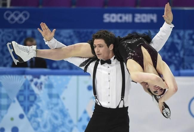 Canada's Tessa Virtue and Scott Moir (London, Ontario) perform their short dance in the ice dance portion of the team figure skating event at the Sochi Winter Olympics Saturday, February 8, 2014 in Sochi. THE CANADIAN PRESS/Paul Chiasson