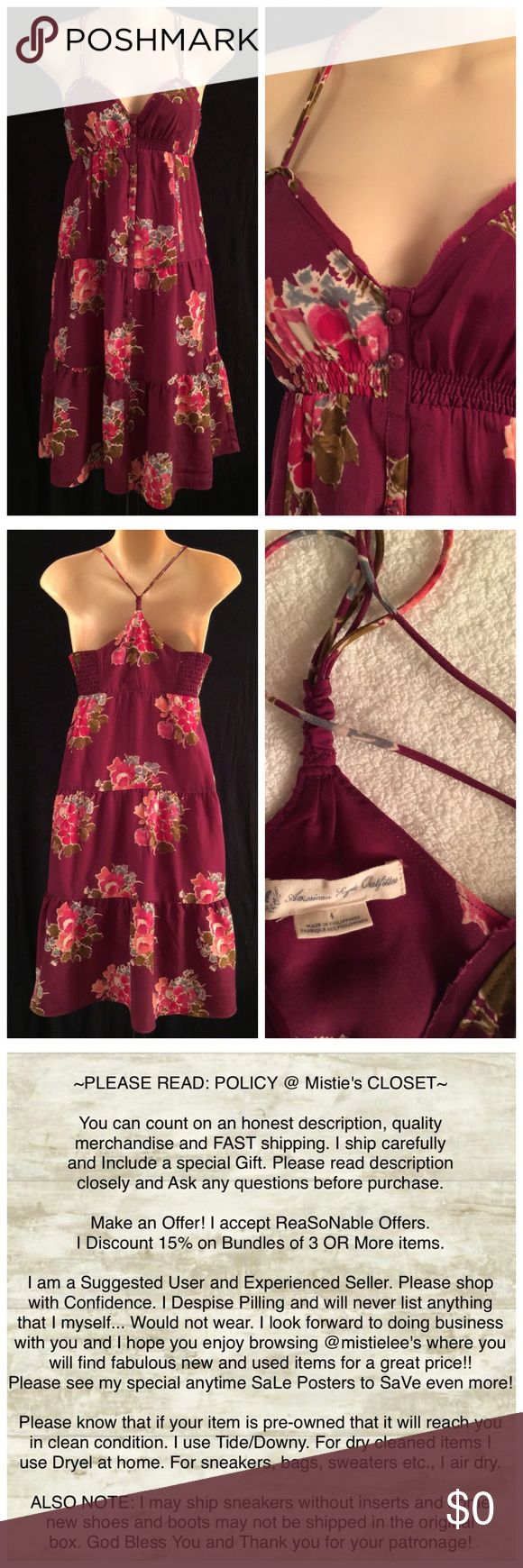 "Raspberry/Pinks AE Outfitters FuN Sun Dress Size 4 Made by: AE Outfitters Size 4 Raspberry Floral w/Pinks Sweetheart Neckline with extra crude edge hem design Double Tiny Strap Racer Back Style Silky Polyester Button Front Empire Waist Drop Layer Sun Dress. Back has Elastic Sides for a perfect fit. Chest and back are lined. Measurements: Underarm to Underarm 15.5""+Stretch Elastic Underarm to Hem Length 28.5"". Pre-Loved: Purchased this dress w/another color. This one may have been worn twice…"