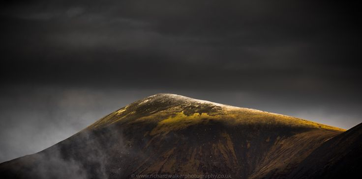 Skiddaw - Sunlight falls on a snow-capped Skidded in the Lake District, UK. Shot from Ashness Bridge.  www.richardwalkerphotography.co.uk