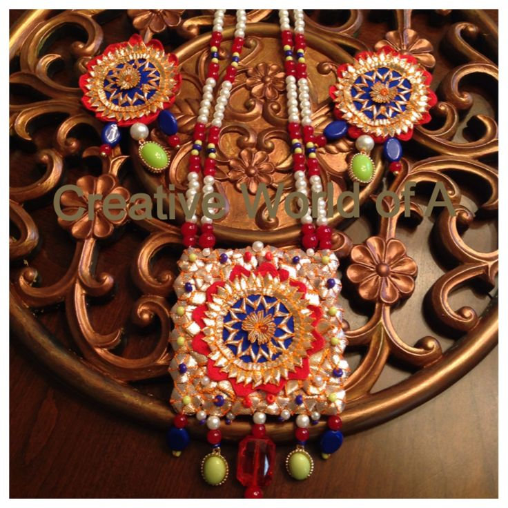 Golden gota with red, green,blue beads. Creative World of A