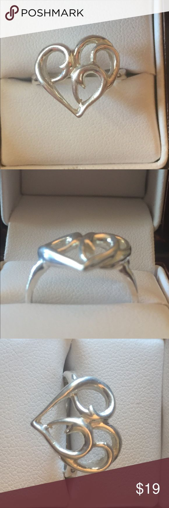 Sterling silver heart ring brand new, handmade Made by me in my studio this .925 sterling silver ring is a very beautiful modern take on the iconic heart shape. No nickel or fake metals, not a cheap import but a medium to heavy weight ring made to last for generations. Large design that will make a statement. I'm a master jeweler and metalsmith and this is one of my designs. I can size this ring if you need me to, and thanks for looking. The inside is stamped STERLING. Jewelry Rings