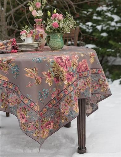 Plump cabbage roses and chicory blooms sprawl upon a lovely cotton tablecloth perfect for your mismatched china.