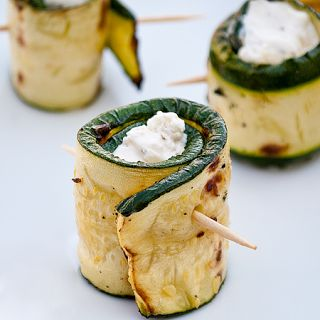 Zucchini, roasted and filled with garlic-herb cheese spread. So easy and can make ahead- serve room temp.