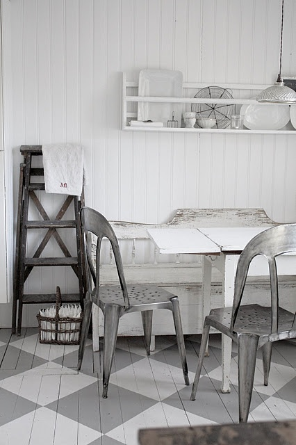 on wood or the existing concrete, you could repaint - at little cost - with floor paint in a design and colour/s of your choice, and really make a big change without too big of a commitment. This white and grey is a nice pairing.