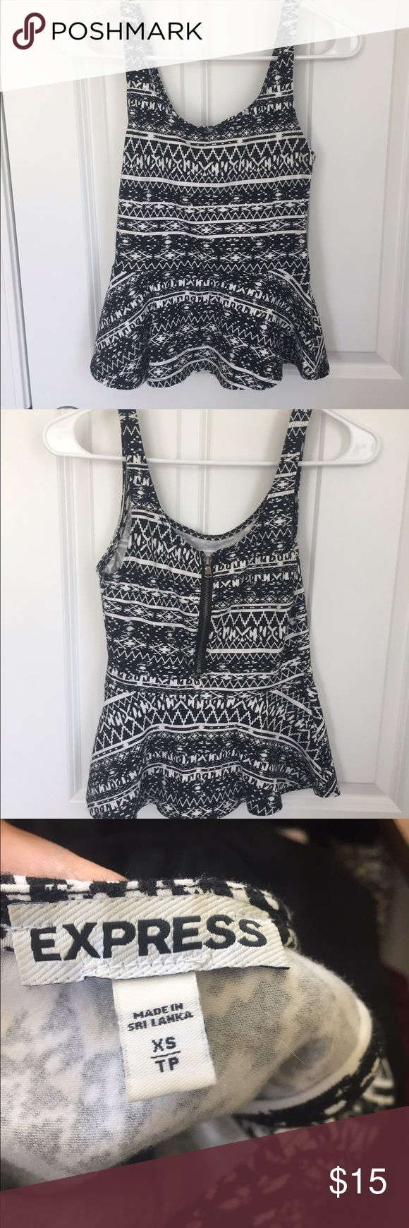 Black & white Aztec print express peplum top Black & white Aztec print express peplum top xs with a zip up back Express Tops Blouses