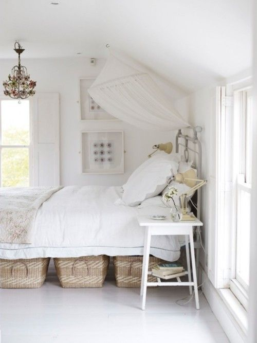 White beachy bedroom. peaceful by perky. Love the white with cane baskets under the bed!