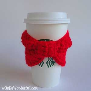 Red Bow Cup Cozy: Crochet for your coffee cup! 10 free #crochet coffee sleeve patterns to make today! Great for gifts and keeping fingers safe! ♥