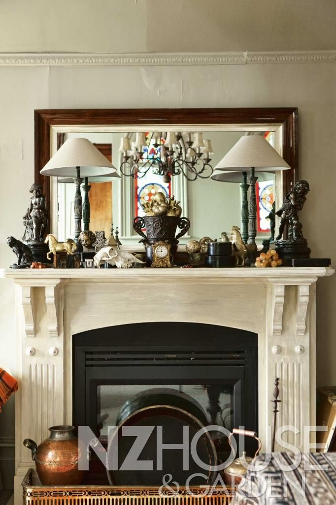 The mantelpiece in the bedroom hosts a collection of bronzes – the two upright figures at either end are Spring and Winter and the bronze dogs are Belgian griffons, which Janey's mother used to breed.