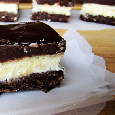 Samoas Nanaimo Bars- The classic Canadian dessert with a Samoas cookie crust, custard butter filling, and chocolate ganache. By Rumbly in my Tumbly