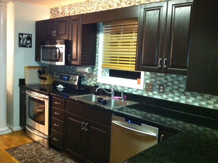 Dark brown cabinets with Black countertops....Love!   Around the ...