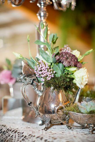 Vintage silverware and floral decor. See more here: Baby's Breath & Succulents – South African Farm Wedding
