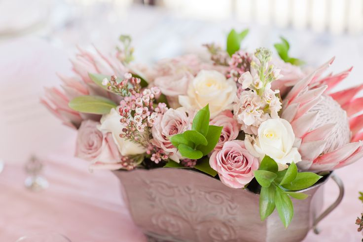 Romantic table centerpieces with King Protea and Pink Roses Styling by Splendid Affairs Photography: Laura Jane Photography