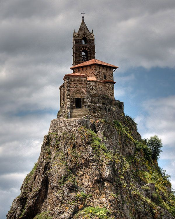 Perhaps one of the most remarkable sights in France, a chapel perched on a volcanic plug. This is the Rock of Aiguilhe, on the edge of the town of Puy en Velay, in the Auvergne. The Chapelle Saint-Michel has stood there for 1042 years, since Bishop Gothescalk had it built in 962 on his return from a pilgrimage to Santiago del Compostella in Galicia. In 1955 workers found relics under the alter that had been there since it was built.: Built Ins, Church, D Aiguilhe Chapel, France, Rock, Castle, Places