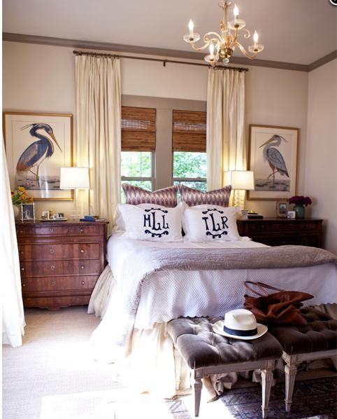 Monogram linens with fabulous bedside chests and art. How fun would this be with a vivid paint color to make things pop? Maybe pulled from one of the birds . . .