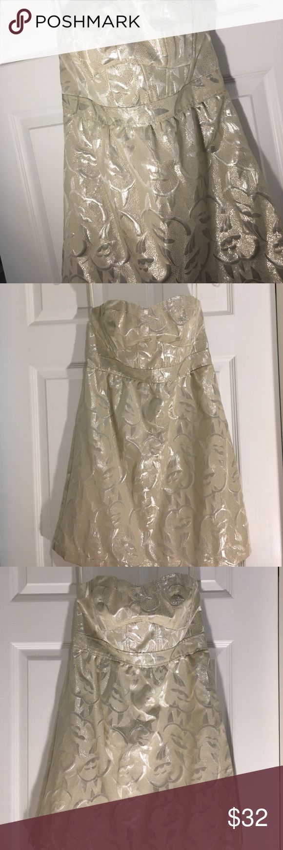 NWT⭐️Gorgeous⭐️ Strapless Shiny Cream Dress Size 4 NWT Gorgeous American Eagle Outfitters Cream Shiny Strapless Dress size 4. This dress is so much prettier than the photos can show. It has metallic thread design in it , would be stunning with silver strappy sandals or silver pumps ! Lined , zips up the side , with some elastic at top of bust which is great ! You could get married in this dress if you are in your 20's and in Vegas .....🌺 No snags , flaws or imperfections 👌 American Eagle…