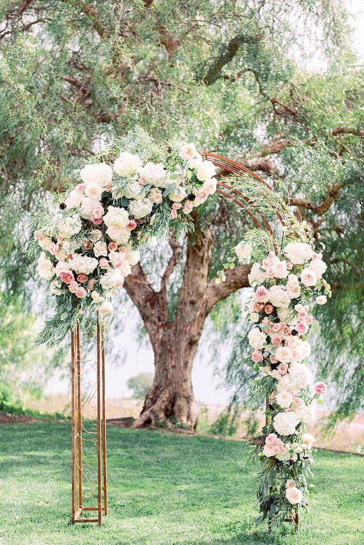 floral ceremony arch - photo by Jana Williams http://ruffledblog.com/waterside-catalina-view-gardens-wedding