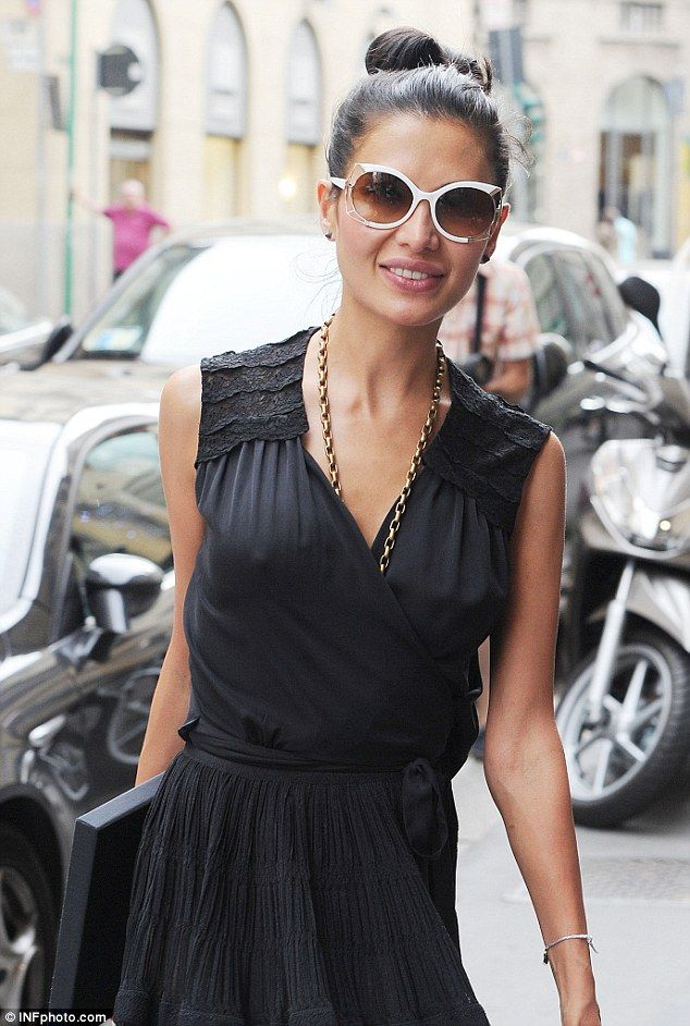 Business style: Goga Ashkenazi combined business and high fashion today as she left a business lunch and returned to her office in Milan, Italy