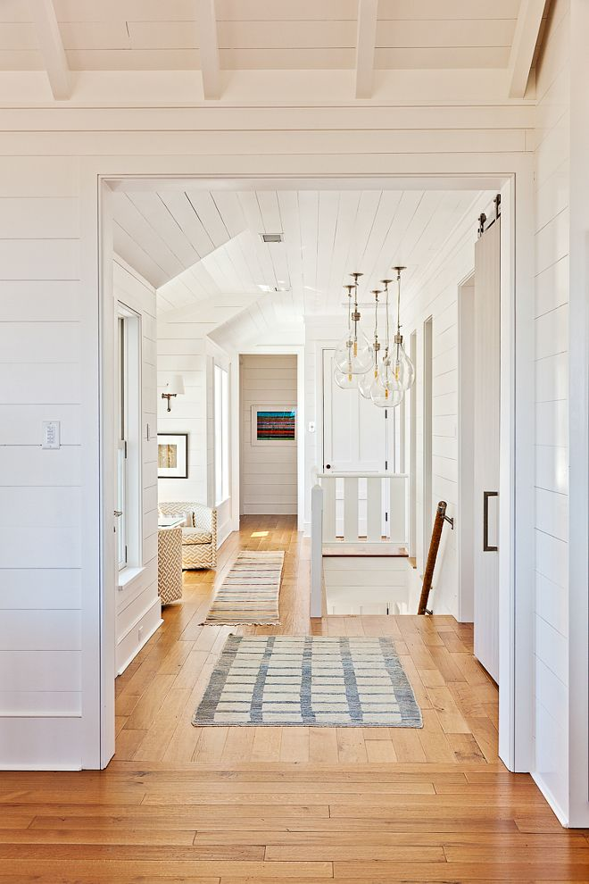 "Shiplap walls and Engineered 6"" White Oak Hardwood Floors with a camel colored finish. Beau Clowney Architects. Jenny Keenan Design"