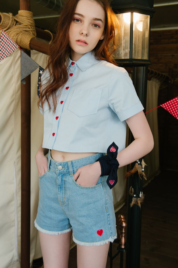 Be the most charming gal on the streets with this unique cropped shirt! It features contrast colored heart buttons in front, a pointed collar,…