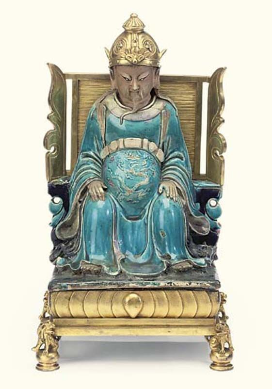 An ormolu-mounted Chinese Turquoise & Aubergine glaxed figure of Zhen Wu 18th century. Christies