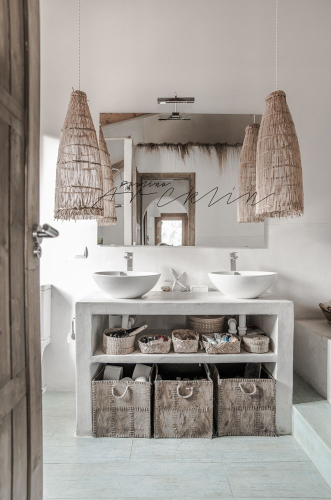 Photography by Paulina Arcklin of a private home in Spain. Like the idea of an open console vanity for a guest bathroom.