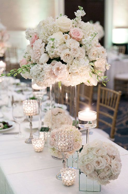 This beautiful centerpiece creates a romantic scene with the roses, hydrangeas, and peonies.