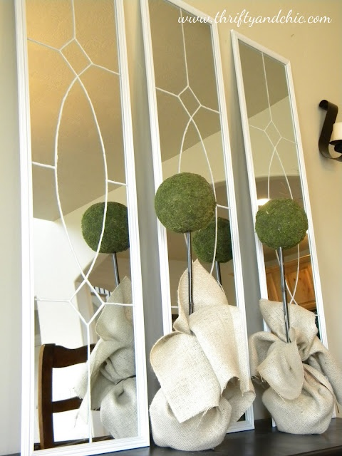 ikea or dollar store mirrors. paint a stencil on it. hang over fire place.