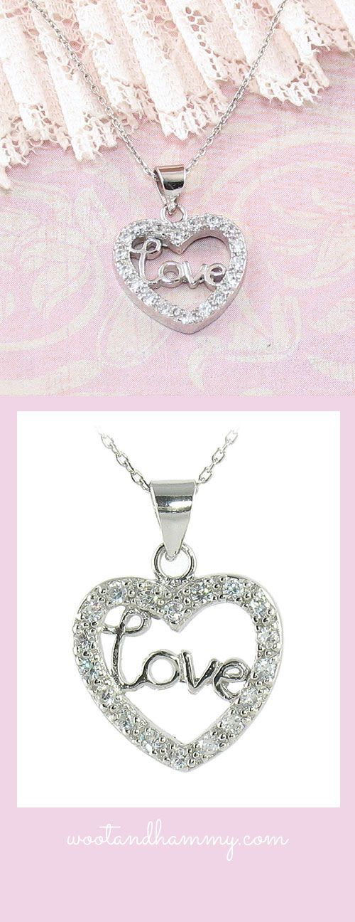 Love heart necklace in sterling silver with cubic zirconia crystals.