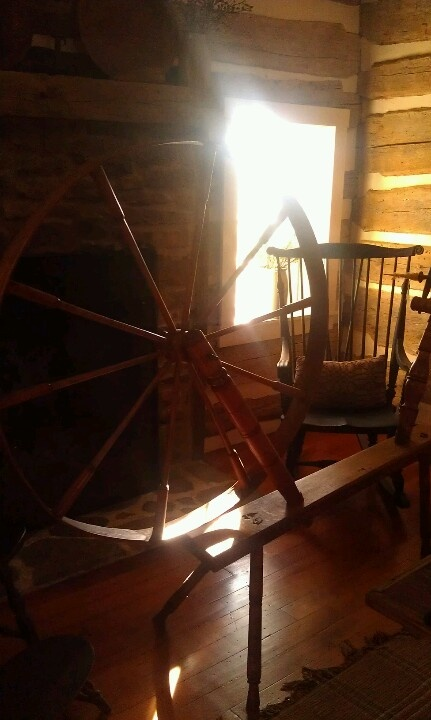 Sunlight through the spinning wheel...love it.  Just like the one my great grandma had...great memory!