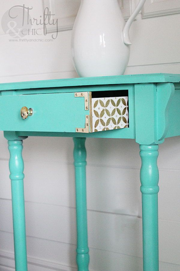 A cute design on the drawer with some gold and white paint. http://hative.com/creative-diy-painted-furniture-ideas/