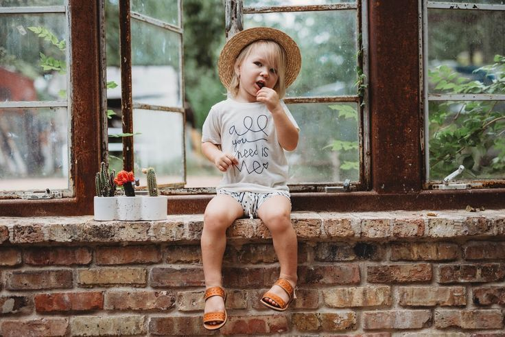 Baby boy clothes, baby girl clothes, baby boy girl outfits, trendy modern hipster baby kids clothes, toddler fashion, fall spring summer, baby sitting, outdoor photo shoot for baby kids ideas, leather sandals, mud cloth shorts, graphic shirt, straw sun hat #babygirlfashion #babyboyshorts #babyboyoutfits #hipsteroutfits #toddleroutfits