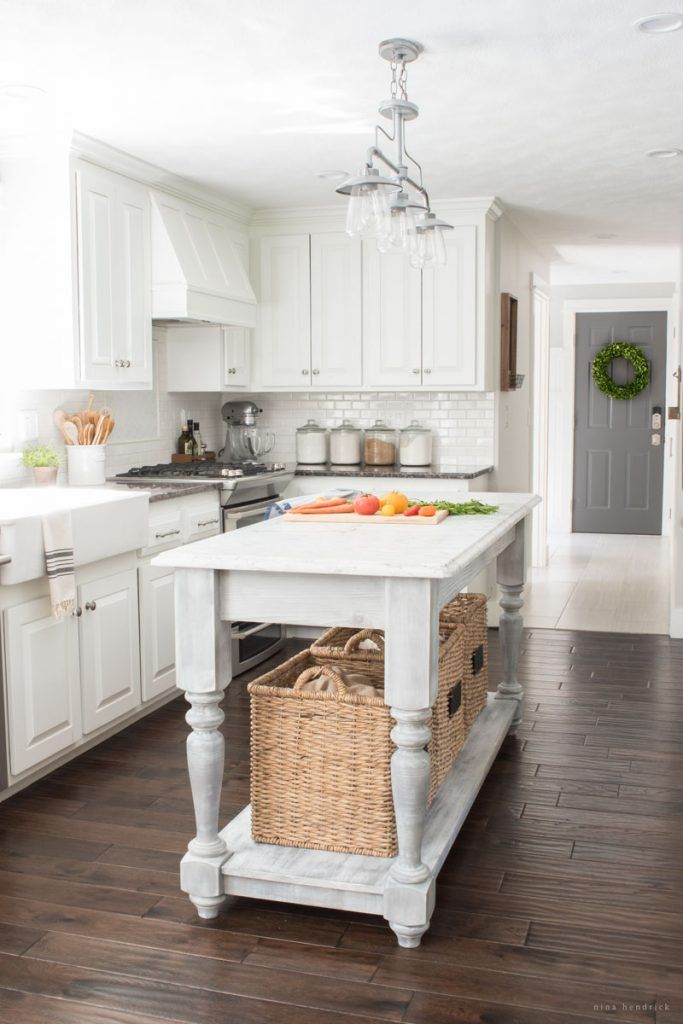 Farmhouse kitchen with painted white cabinets and DIY farmhouse island eclecticallyvintage.com