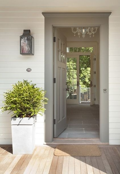 Grey door really sets off the front entrance.  Great planning: open front door and view right through the back door // traditional entry by ZeroEnergy Design.  From houzz