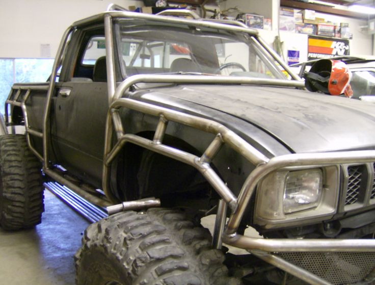 Outer roll cage by flex point off road toyota pickups pinterest toyota design and shops for Interior roll cage for toyota pickup