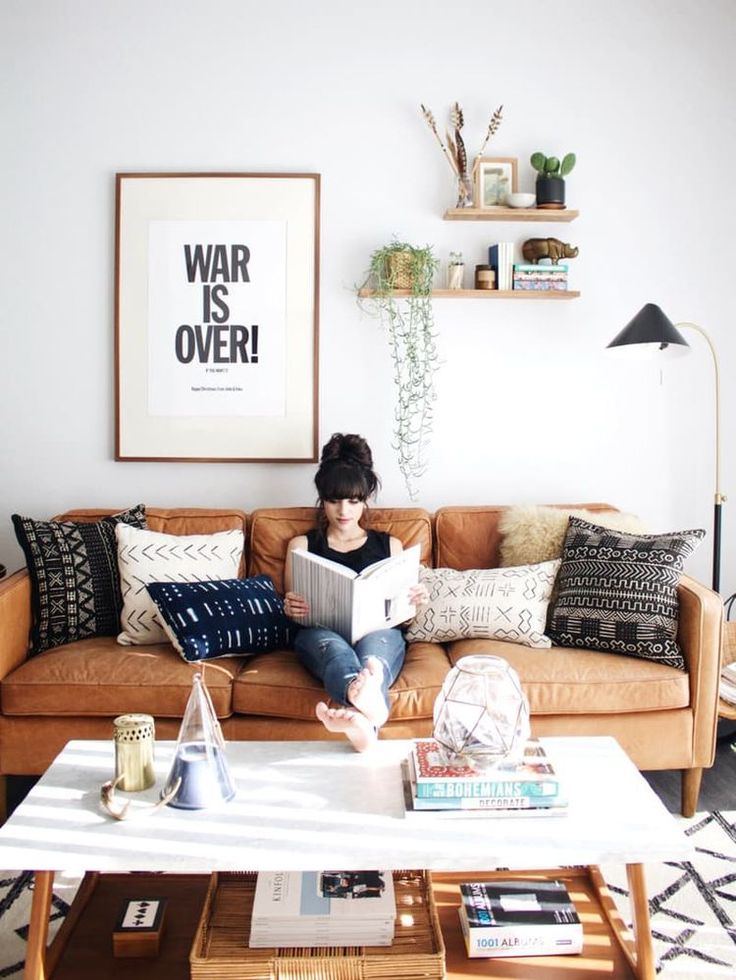 An array of the newly popular mud cloth pillow fills this sofa. Found in all shapes and sizes mud cloth throw pillows are durable, fit any budget, and add character to any space.
