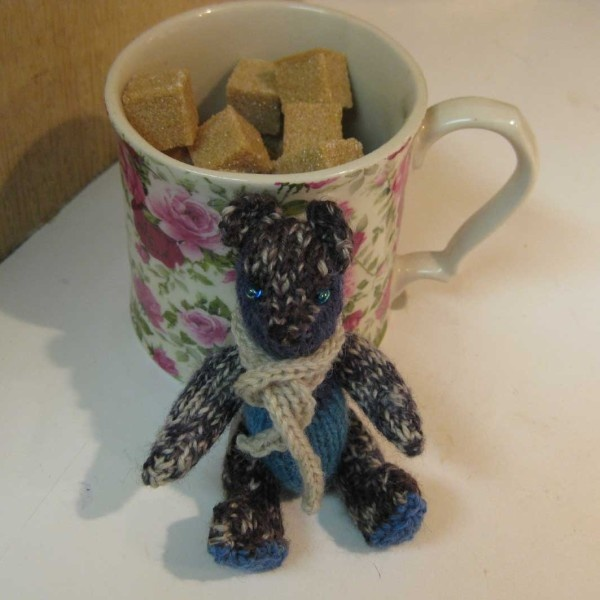 Gregory the hand-made fully-jointed Yarn Stash Bear is teeny tiny!