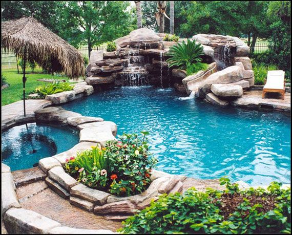 gorgeous rock pool with waterfall hot tub and slide would love this in the back yard it would be cool to have a way to connect an indoor pool with this