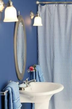 Keep your fabric shower curtain free of mold using simple cleaning tricks...the baking soda and vinegar works WONDERS! thank GOODNESS!