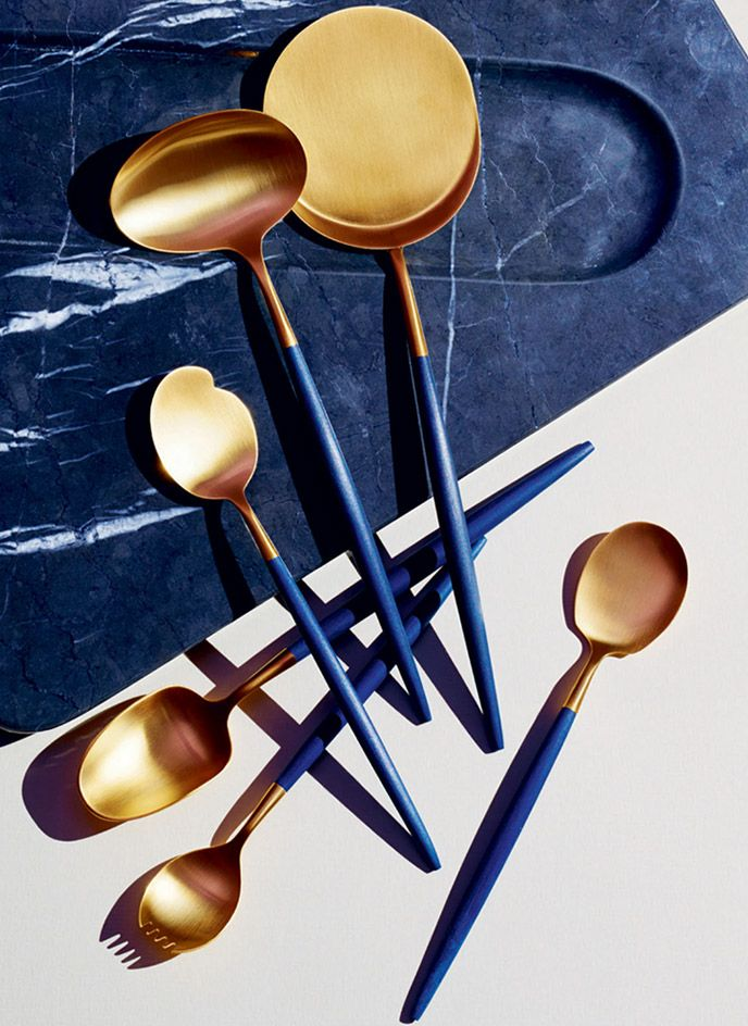 Inspired by his personal collection of vintage cutlery, Simon Rawlings, creative director of David Collins Studio, devised this spoon set, appropriate for cheese, oysters, eggs, caviar, sorbet and soup. Using Cutipol's Goa range as a starting point, the handles feature the studio's signature blue shade. #wallpaperhandmade