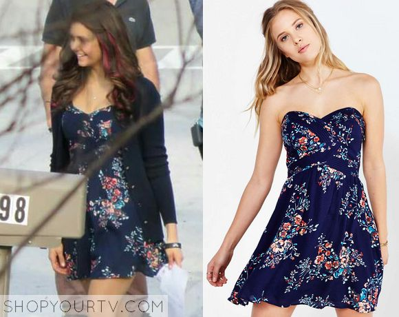Elena Gilbert (Nina Dobrev) wears his navy blue floral print strapless dress in this week's episode of The Vampire Diaries. It is the Urban Outfitters Kimchi Blue Grecian Strapless Mini Dress. Buy it HERE for $69