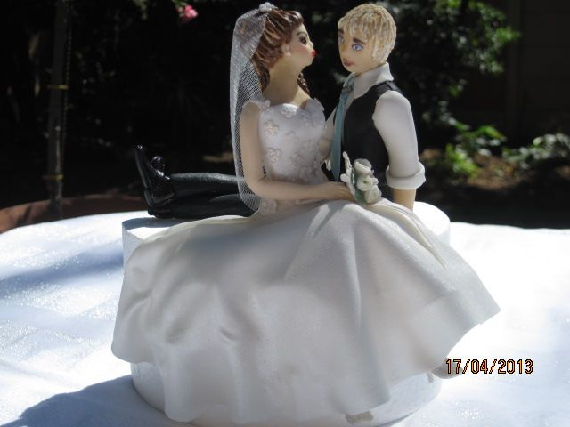 bride and groom made of sugar sitting on the cake.  An original hand made art piece by Tania Riley  Johannesburg, South Africa.  0829316200