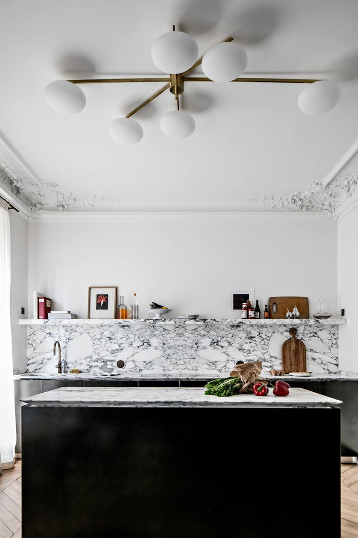 Kitchen in a masculine elegant Paris home by Jean Charles Tomas | Photography © Benoit Linero