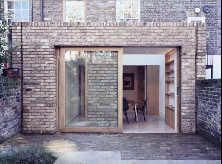 Like this idea. Recess brickwork means glazing can slide right across.  www.methodstudio.london