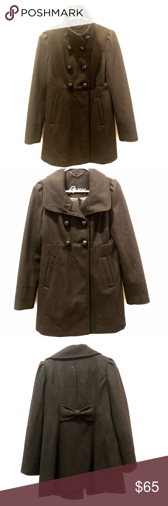 Guess woman's size small black pea coat Cute dressy black pea coat with large buttons, high collar, and a bow in the back. Love this but have only worn it a handful of times- looks great with little signs of wear! Guess Jackets & Coats Pea Coats